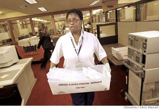 San Francisco election clerk Donna Hopkins (cq) carries a tray of absentee ballots after examining them for missing signatures in the Department of Election office at City Hall. Photographed November 6, 2007.  Chris Stewart / The Chronicle Photo taken on 11/6/07, in San Francisco, CA, USA Donna Hopkins, absentee ballots, election, San Francisco Photo: Chris Stewart