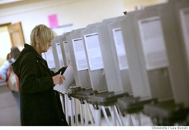 election06_055_ls.jpg  Marjorie Johansen finishes filling out her ballot on Monday at City Hall. Absentee voters at City Hall on Monday.  Lea Suzuki / The Chronicle Photo taken on 11/5/07 in San Francisco, CA, USA. Photo: Lea Suzuki