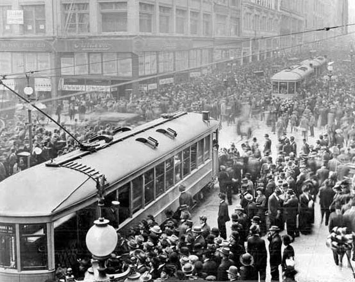 MUNI1/B/05OCT99/MN/HO--Muni streetcars at Geary and Kearny Streets on the first day, December 28, 1912. CAT