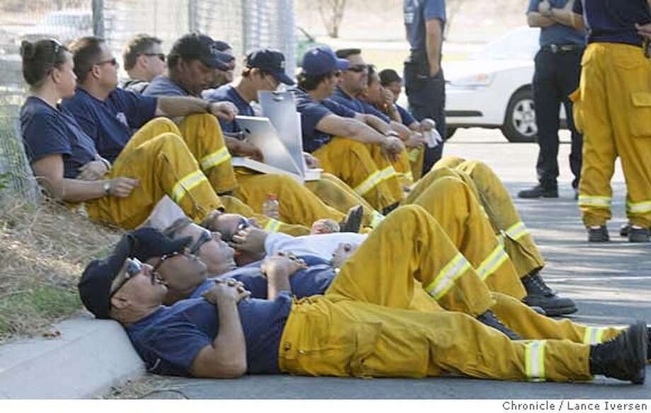SOCALFIRES_77432.JPG  San Francisco Firefighters take a break at a base camp in Castaic California after being on duty for two days protecting homes in the path of the Ranch Fire west of Santa Clarita as they wait for new orders that will take them down to San Diego to fight the Harris and Witch fires Wed night. . OCTOBER 24th, 2007. Lance Iversen/The Chronicle (cq) SUBJECT 10/24/07,in CASTAIC. CA. MANDATORY CREDIT PHOTOG AND SAN FRANCISCO CHRONICLE/NO SALES MAGS OUT Photo: By Lance Iversen