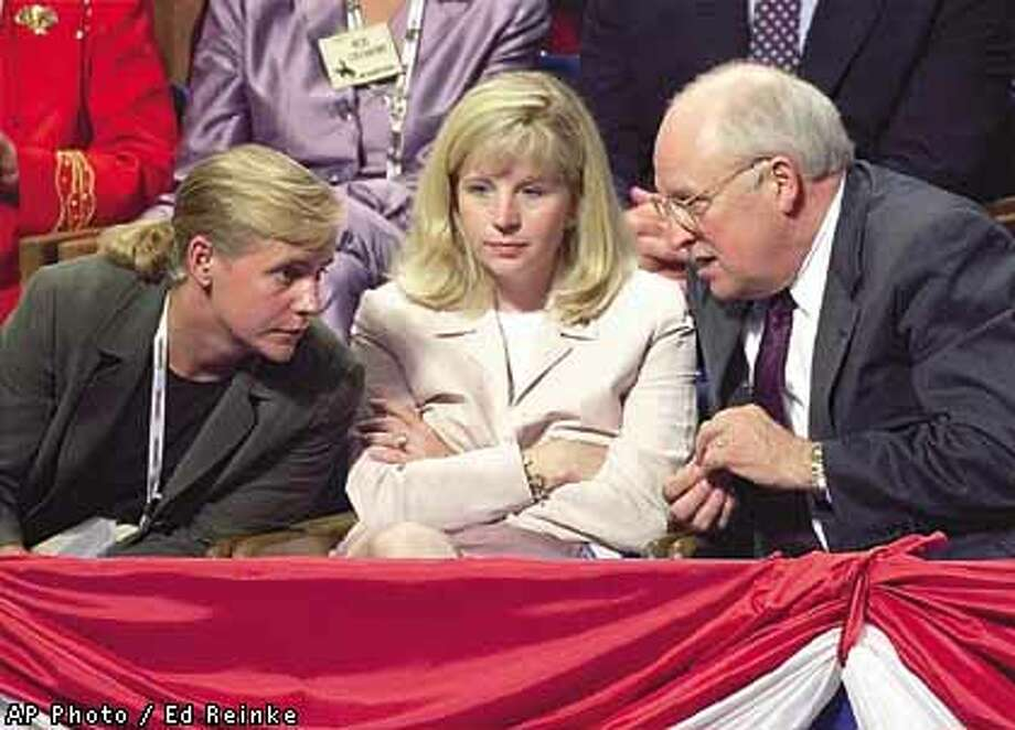 Dick Cheney conferred with his daughters, Mary (left) and Elizabeth, at the Monday session of the Philadelphia convention. Associated Press photo by Ed Reinke