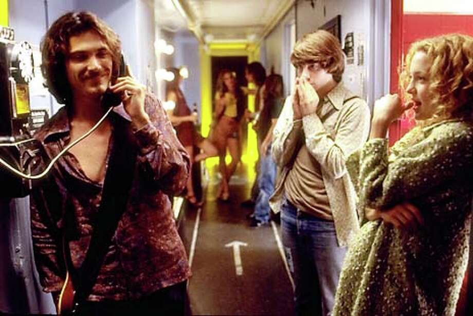 Patrick Fugit (center) stars as a young rock journalist, Billy Crudup plays the guitarist in a band and Kate Hudson is a groupie in ``Almost Famous.''
