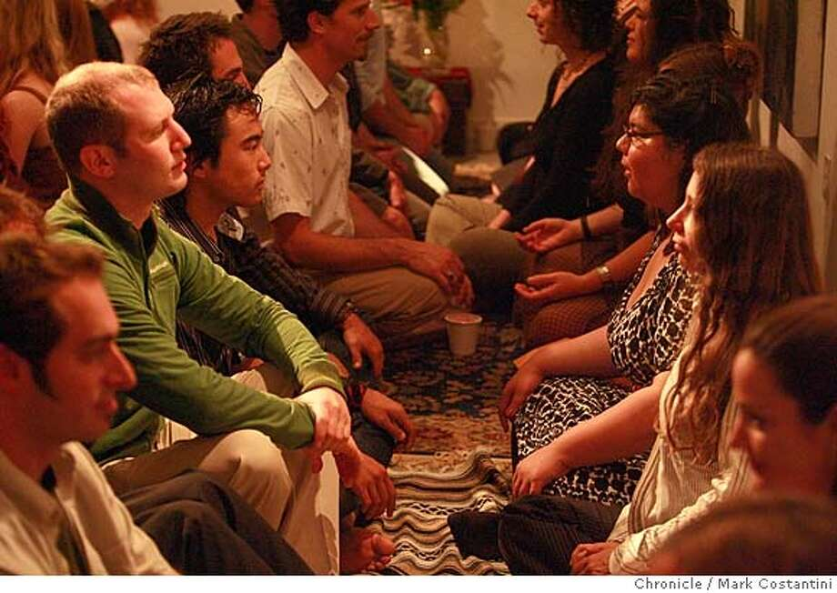 Attendees of the West Coast debut of Eye Gazing Parties. These parties have been happening all over the world, and now they are coming to San Francisco ... The eyes are the window into the soul, so it's a lot easier to have a mesmerizing conversation with someone new after you've spent two minutes looking into his or her eyes. That is the simple idea behind Eye Gazing Parties. PHOTO: Mark Costantini / The Chronicle Photo: MARK COSTANTINI