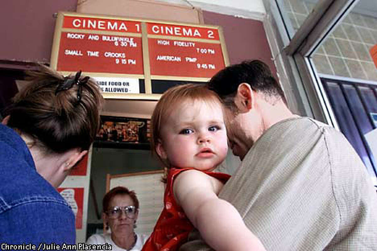 FILE - In this July 31, 2000 photo, ten-month-old Grace Jewell Brown waits for her parents to purchase tickets at Baby Brigade night at Oakland's Parkway Theater.