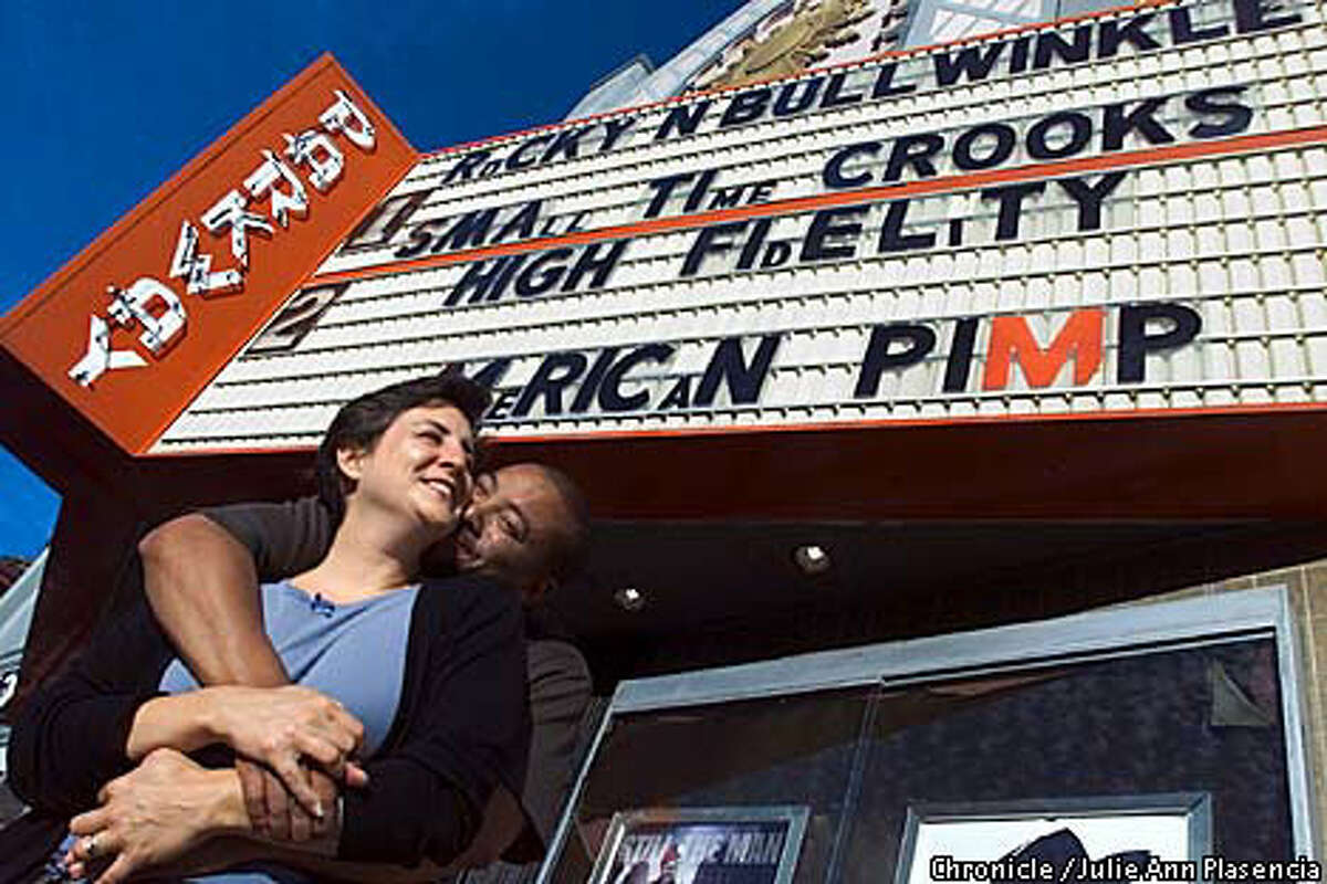 FILE - In this July 31, 2000 photo, the former owners of Oakland's Parkway Theater, Catherine and Kyle Fischer, stand in front of the movie house.