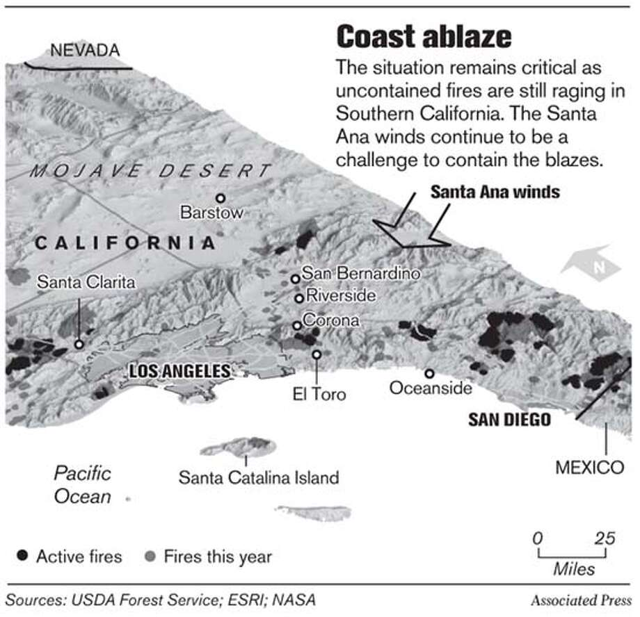 Coast Ablaze. Associated Press Graphic