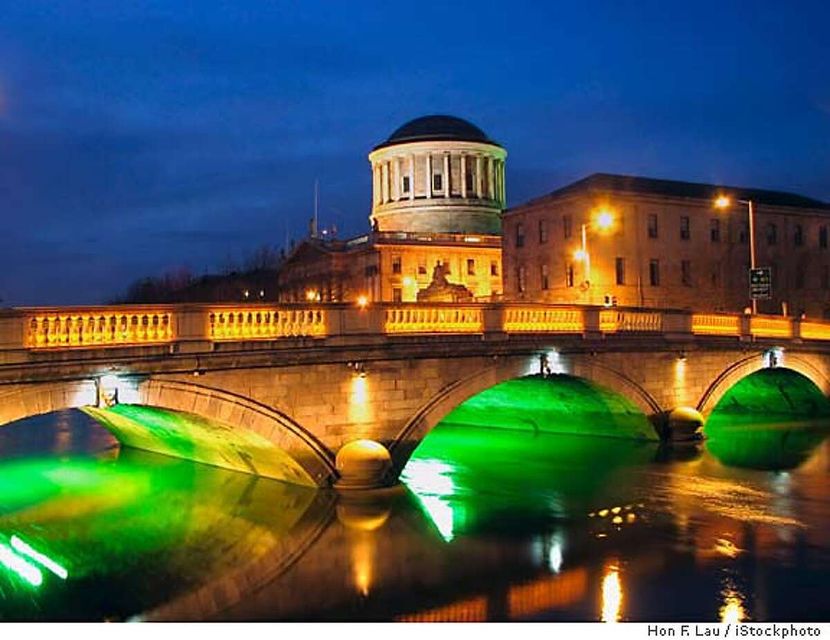 The Four Courts building looms over the Gratton Bridge in Dublin. iStockphoto photo by Hon F. Lau