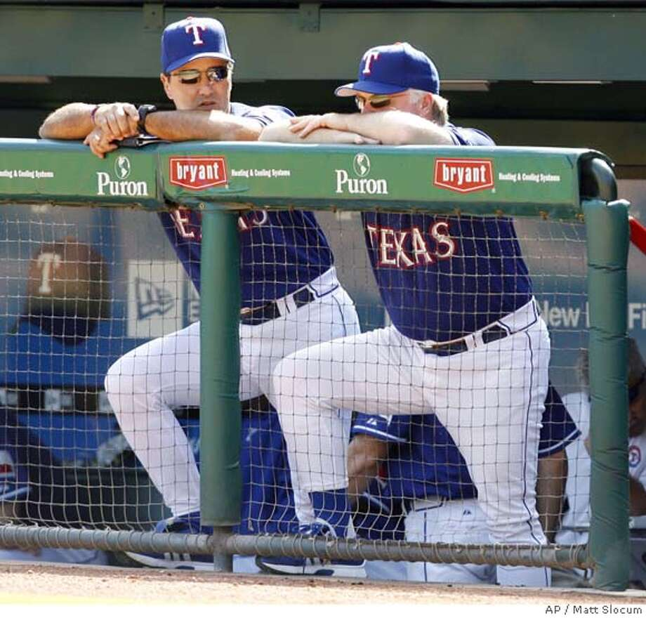 Texas Rangers manager Buck Showalter, right, and bench coach Don Wakamatsu watch from the dugout as the Rangers lose to the Cleveland Indians, 11-6, in their final home game of the season, Sunday, Sept. 24, 2006, in Arlington, Texas. Showalter was fired as manager of the Texas Rangers on Wednesday, ending four seasons in which he was never able to get a team with several young All-Stars above third place in the AL West. (AP Photo/Matt Slocum)  Ran on: 10-08-2006  Don Wakamatsu is a candidate to become Rangers manager. A SEPT. 24, 2006 PHOTO Photo: MATT SLOCUM