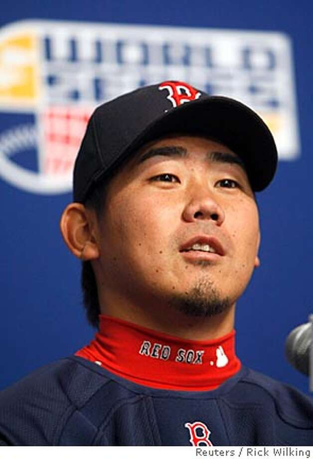 Boston Red Sox pitcher Daisuke Matsuzaka, who will be starting against the Colorado Rockies in Game 3 of Major League Baseball's World Series, attends a news conference in Denver, Colorado October 26, 2007. REUTERS/Rick Wilking (UNITED STATES) Photo: RICK WILKING