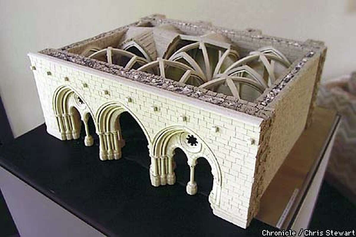 An architectural scale model represents the