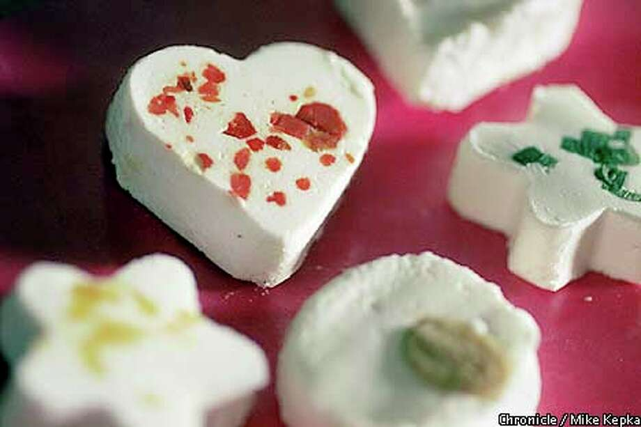 Chevre in heart and star shapes can perk up the holiday party table. Chronicle photo by Mike Kepka