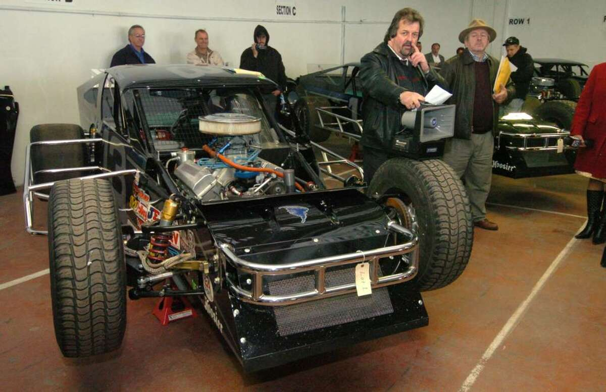 Auctioneer Paul Erickson, of Worster, MA, leads an auction of seized property of James Galante's at Metro Auto Body & Towing in Harford, CT, Friday, Nov. 6, 2009. The property consisted of racing cars and parts.