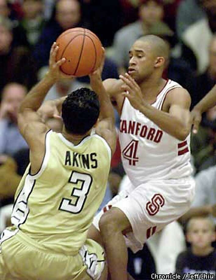 Stanford guard Mike McDonald stopped the progress of Georgia Tech's Tony Akins on a drive in the first half of last night's 80-66 Cardinal win. Chronicle photo by Jeff Chiu