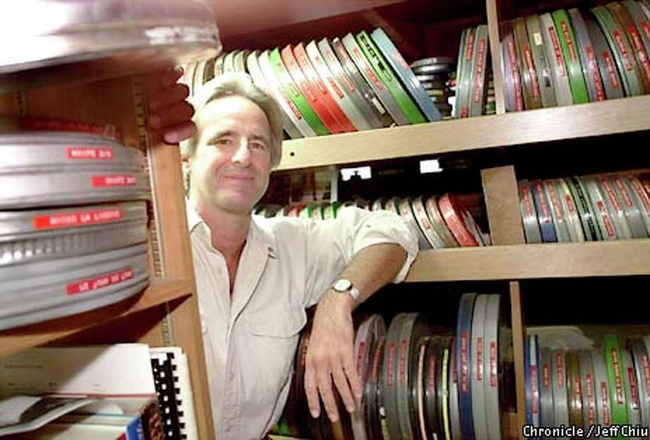 Geoff Alexander with his collection of thousands of 16mm films. Chronicle photo by Jeff Chiu