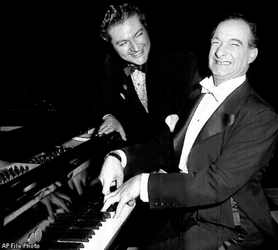 Pianist-comedian Victor Borge (right) drew a laugh from Liberace while mimicking the style of the flamboyant entertainer in this 1954 photo. Associated Press file photo / AP
