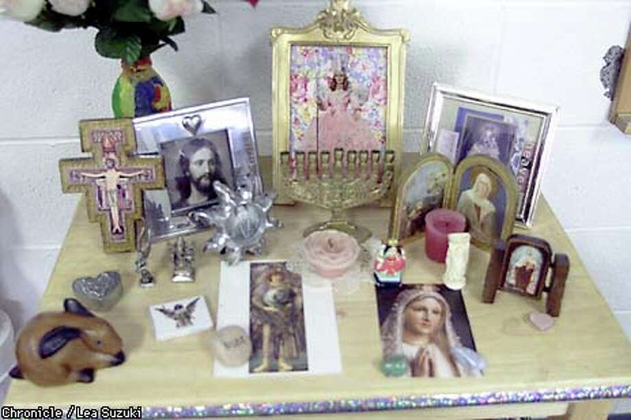 "A universal altar in a Living Wisdom School classroom included a bunny, a heart and Glenda the Good Witch from ""The Wizard of Oz."" Chronicle photo by Lea Suzuki"