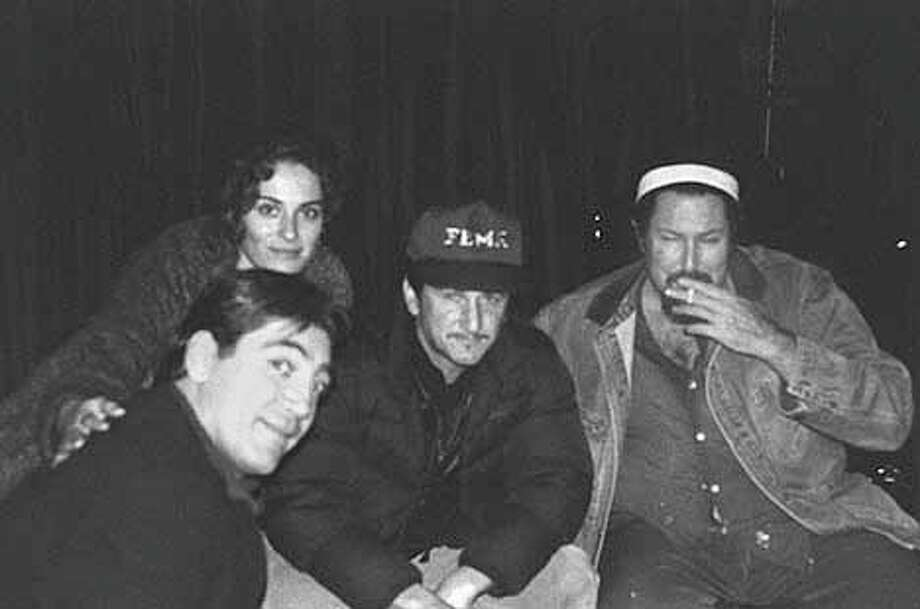 "Sean Penn (center) hangs out with (from left) actor Javier Bardem, Bardem's girlfriend, Kristina Pales, and ""Before Night Falls"" director Julian Schnabel.Photo by Nathalie Peterson, special to the Chronicle / CHRONICLE"