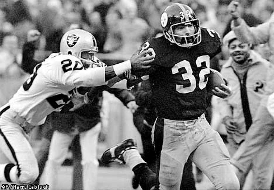 "The Steelers' Franco Harris (32) avoided Oakland's Jimmy Warren after making the ""Immaculate Reception.""  Associated Press photo by Harry Cabluck, 1972 / AP"