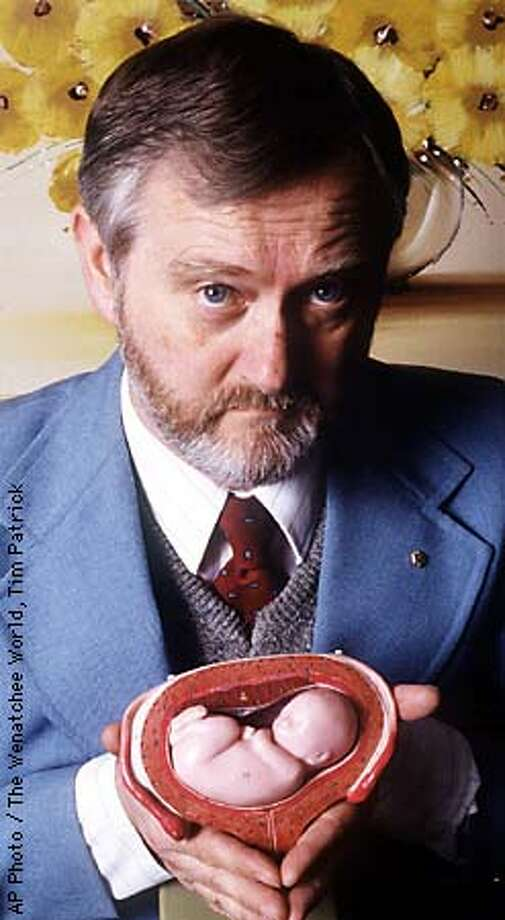 FILE--Anti-abortion activist Richard T. Andrews of Wenatchee, Wash., holds a model of a fetus in this file photo from April 25, 1989. Andrews, suspected in connection with suspicious fires at seven western abortion clinics between 1992 and 1995, has agreed to a plea bargain, the Justice Department said Monday, Feb. 9, 1998, in Sacramento, Calif. (AP Photo/The Wenatchee World, Tim Patrick). Photo: TIM PATRICK