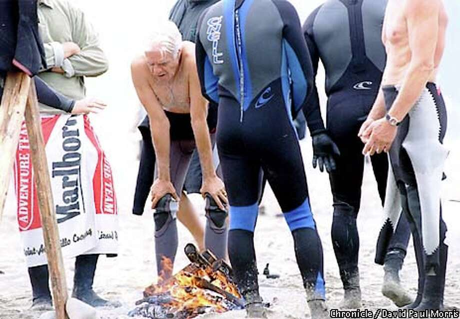 """Rob """"Birdlegs"""" Caughlan (left) took a breather between heats of a surf contest in Pacifica. Chronicle photo by David Paul Morris"""