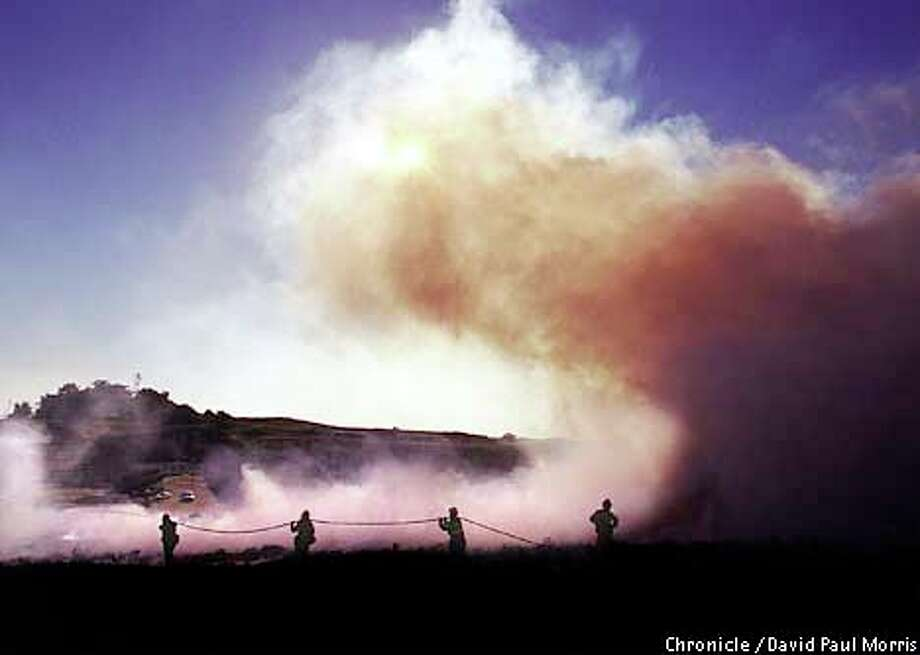 Presidio Fire Department workers battled a grass fire in the Marin Headlands fanned by winds that reached 100 mph in parts of the Bay Area. Chronicle photo by David Paul Morris / CHRONICLE