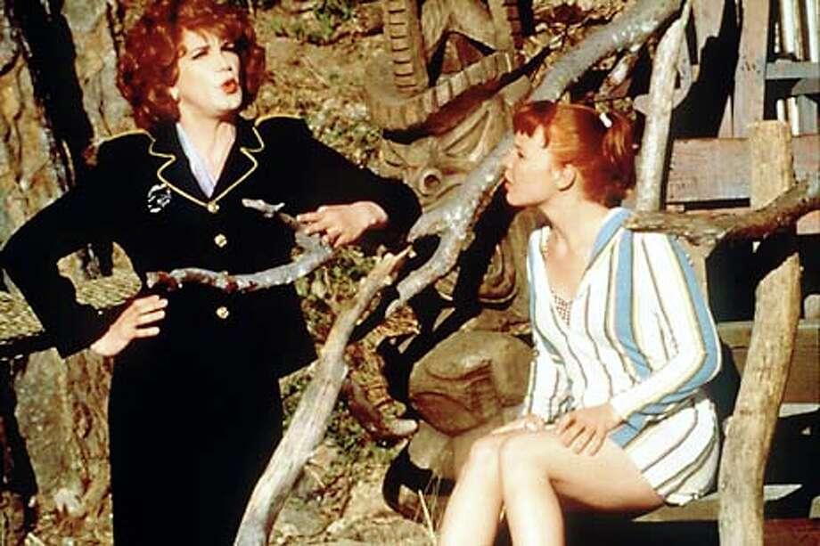 "Charles Busch plays sheriff's Capt. Monica Stark, who's trying to find a killer, and Lauren Ambrose is Chicklet, a girl who wants to surf with the boys, in ""Psycho Beach Party.'' / CHRONICLE"