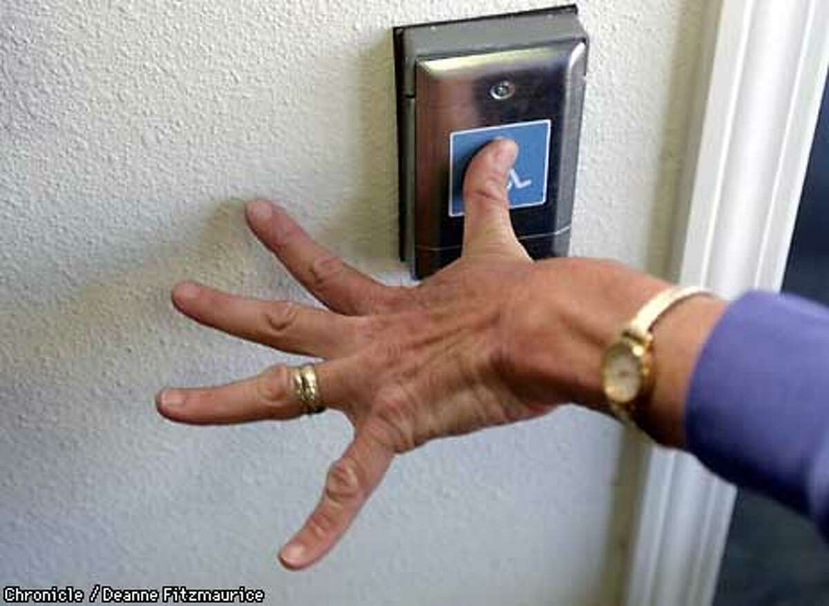 Electronic door openers, like this one in Berkeley, are common in public buildings since the passage of the American Disablities Act ten years ago. Chronicle photo by Deanne Fitzmaurice