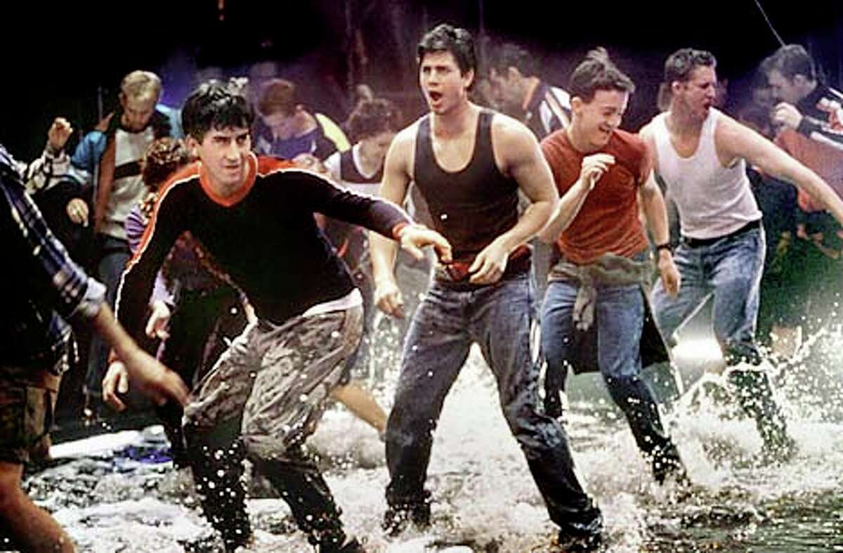 Adam Garcia (center) plays a steelworker who'd rather be tap-dancing in the Australian film ``Bootman,'' from the creator of the stage show