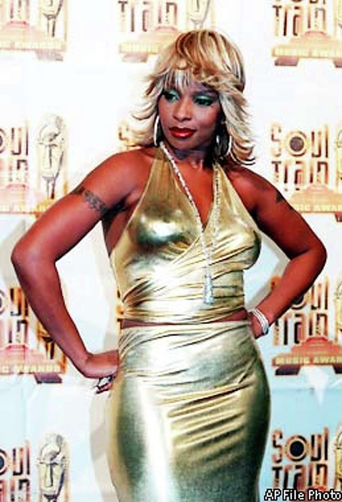 """Mary J. Blige poses backstage at the 14th Annual Soul Train Music Awards at the Shrine Auditorium in Los Angeles Saturday night, March 4, 2000. Blige was honored as Female Entertainer of the Year. Her album """"Mary"""" also won Best R&B/Soul Album, Female. AP File Photo by Chris Pizzello"""