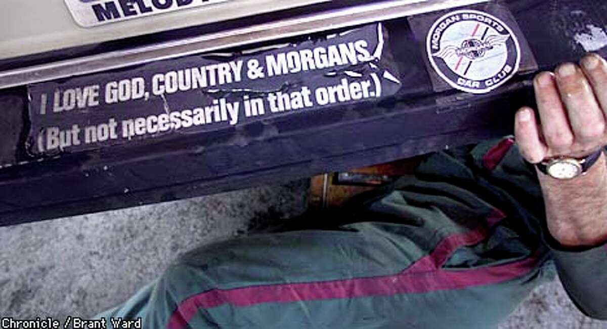 A bumper sticker on a car owned by one of the Morgan enthusiasts says it all. The small British car maker has a devoted following. Chronicle Photo by Brant Ward