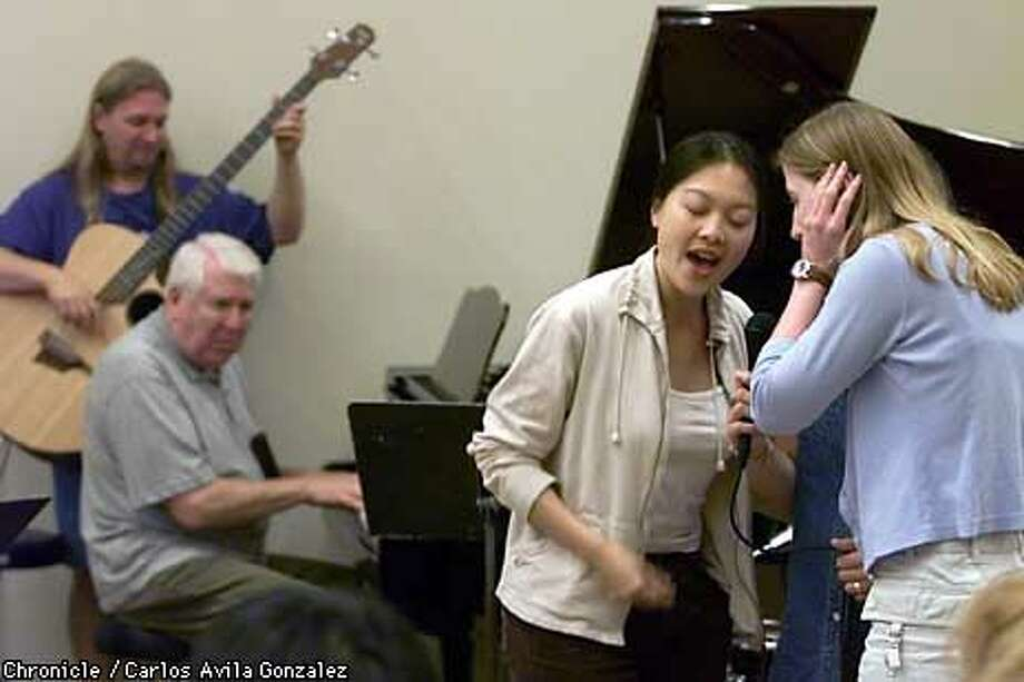 Jazz students Jennifer Lay Shuy (center) and Jody Gardino practiced their singing with jazz pianist Don Haas after a lecture at Stanford University's jazz workshop. Chronicle Photo by Carlos Avila Gonzalez
