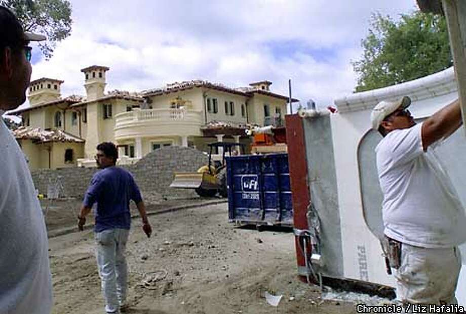 Work such as this project on Edwards Lane is common in Atherton with about 300 of its 2,500 homes being remodeled at any given time.  Chronicle photo by Liz Hafalia / SAN FRANCISCO CHRONICLE