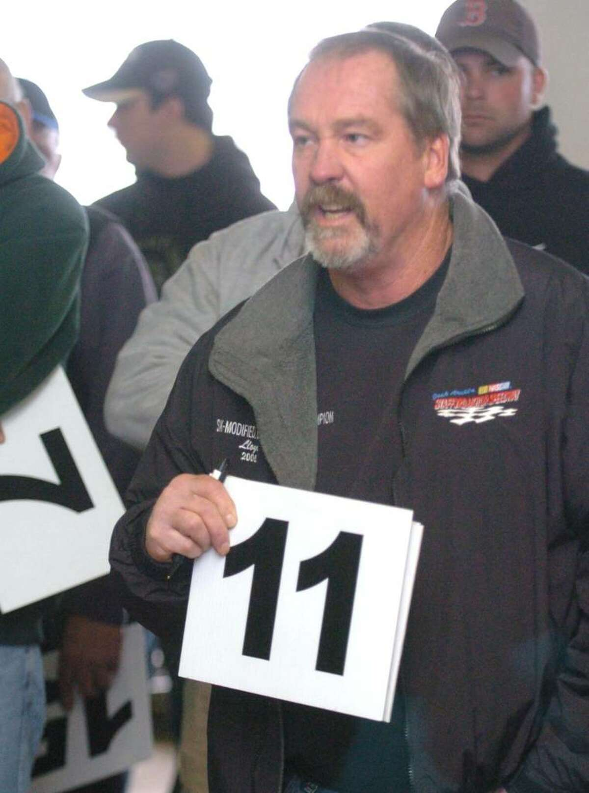 Lloyd Agor, of New Milford, bids on seized property of James Galante's at Metro Auto Body & Towing in Harford, CT, Friday, Nov. 6, 2009. The property consisted of racing cars and parts.