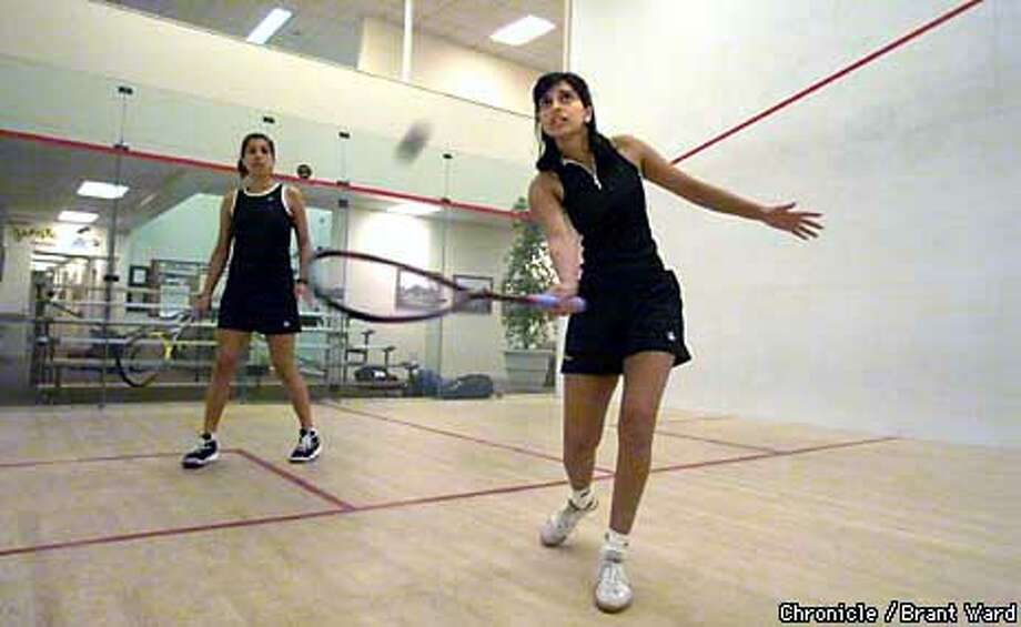 Shabana Khan (right) and her sister, Latasha, are the daughters of 10-time all-India champion Yusuf Khan. They are playing in the Bay Club's International Squash Challenge. Chronicle photo by Brant Ward