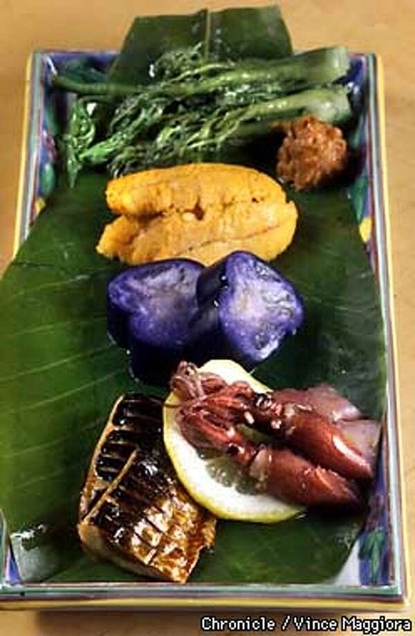 Taranome vegetable, steamed sea urchin, wasabi eggplant, squid and sardines. Chronicle photo by Vince Maggiora