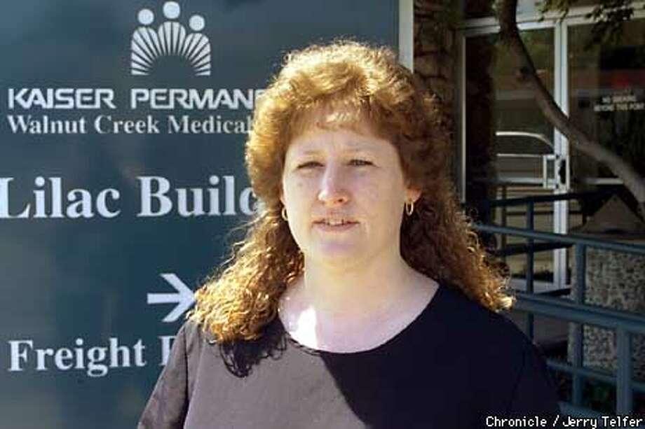 Chris Beltran is a nurse at Kaiser Permanente's Walnut Creek, CA phone advice center. Chronicle Photo by Jerry Telfer / CHRONICLE