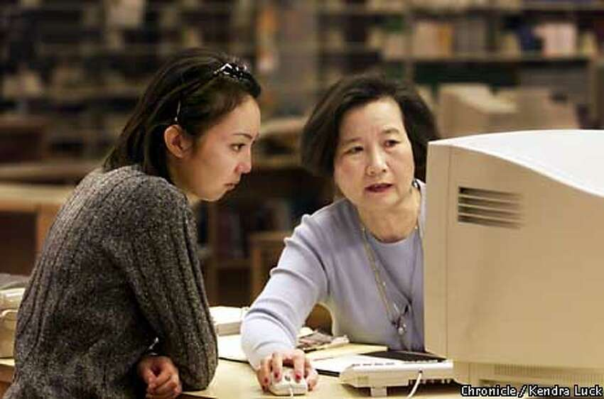 Tomoko Oikawa was helped by reference librarian Susana Liu in San Jose State University's Clark Library. Chronicle Photo by Kendra Luck