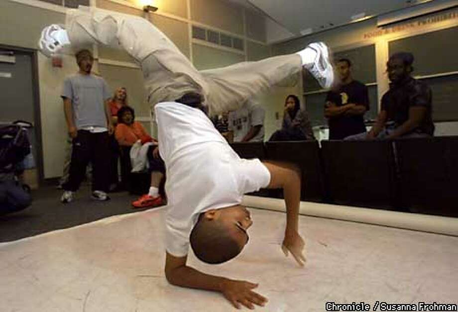 """Yosef Girmay, a Cal student and member of the breakdancing troupe called the """"B-Boys"""", competed in a hip-hop presentation during the final day of the """"Powermoves: Hip-Hop Culture and Sociology"""" class.  Chronicle Photo by Susanna Frohman"""