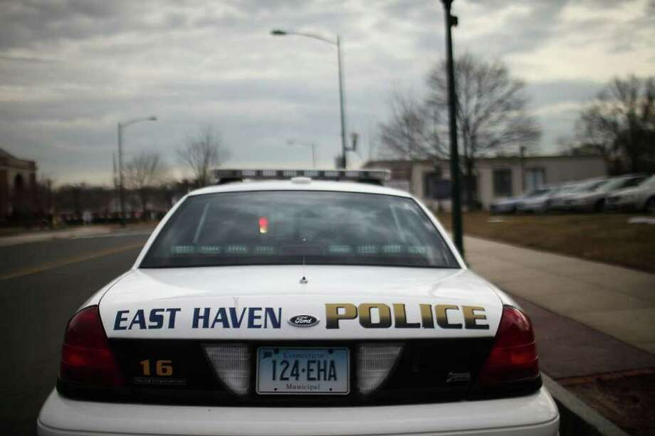 EAST HAVEN, CT - FEBRUARY 01:  An East Haven Police car is viewed on February 1, 2012 in East Haven, Connecticut. Following an investigation by the FBI, four East Haven police officers were arrested last week and accused of abusing Latinos in the working class community of 28,000 people which was nearly predominately white a generation ago. A recent civil rights investigation which was released last month revealed a pattern of discriminatory policing East Haven and the town has been warned by the U.S. Justice Department to make reforms. The arrested officers have been accused of subjecting Hispanics to beatings and false arrests among other things. Currently East Haven's Latino population is around 10 percent.  (Photo by Spencer Platt/Getty Images) Photo: Spencer Platt, Getty Images / 2012 Getty Images