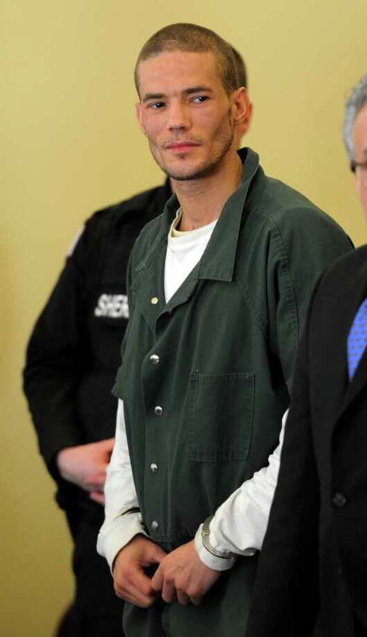 Michael Moon, 36, center appears in Rensselaer County Court  in Troy, N.Y. on Friday, Feb. 10, 2012, for his arraignment on charges that alleged he robbed stores between Sept. 15 and Oct. 17.  (Skip Dickstein / Times Union) Photo: SKIP DICKSTEIN / 2011