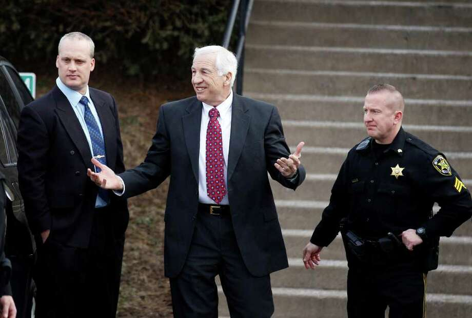 Jerry Sandusky, left, a former Penn State assistant football coach charged with sexually abusing boys, arrives with his attorney Joe Amendola, at the Centre County Courthouse for a bail conditions hearing Friday, Feb. 10, 2012 in Bellefonte, Pa. (AP Photo/Alex Brandon) Photo: Alex Brandon, STF / AP