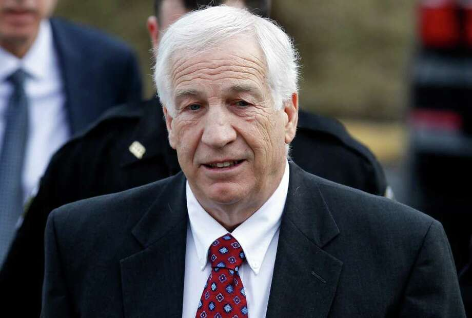 Jerry Sandusky, left, a former Penn State assistant football coach charged with sexually abusing boys, arrives at the Centre County Courthouse for a bail conditions hearing Friday, Feb. 10, 2012 in Bellefonte, Pa. (AP Photo/Alex Brandon) Photo: Alex Brandon, STF / AP