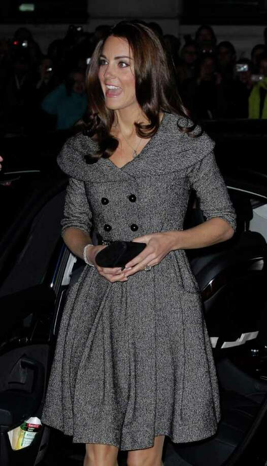 Kate Duchess of Cambridge arrives to attend the opening evening of the Lucian Freud Portraits exhibition at the National Gallery in London, Wednesday, Feb. 8, 2012.  The gallery is showing more than 100 paintings completed over 70 years, many of them nude studies of the late British artist's friends and family. Freud worked with the gallery on the exhibition for several years before his death in July 2011 aged 88.  (AP Photo/Matt Dunham) Photo: Matt Dunham / AP
