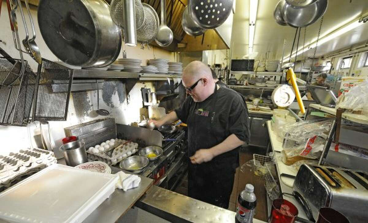 Cook Stephen LaPierre whips up some scrambled eggs at the Miss Albany Diner in Albany, N.Y. Feb. 10, 2012. The Miss Albany on Broadway will close after lunch today. Owner Jane Brown is retiring. The iconic north side eatery is being sold to to Matt Baumgartner, the owner of the nearby Wolff's Biergarten. (Skip Dickstein / Times Union) (TIMES UNION)