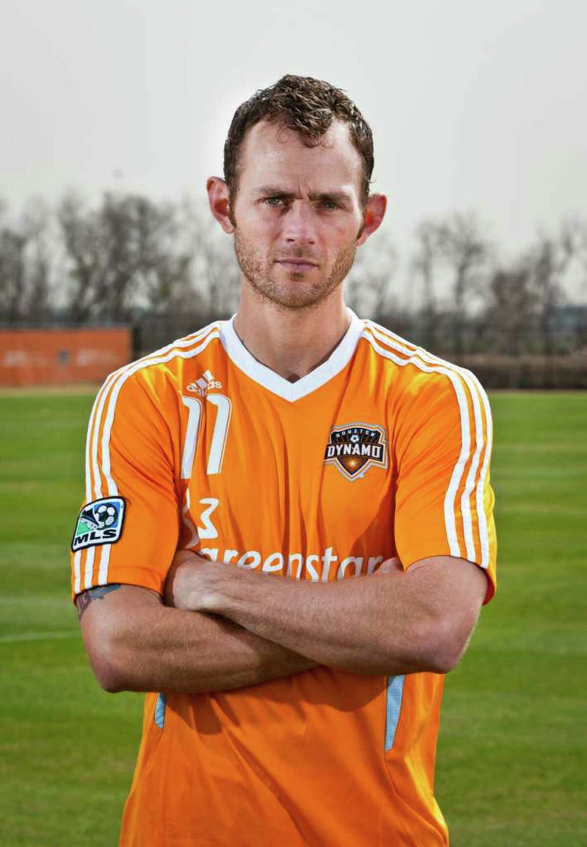 Houston Dynamo midfielder Brad Davis poses for a portrait during the Dynamo's first training session of the 2012 season at Houston Amateur Sports Park's Methodist Champions Field on Monday, Jan. 23, 2012, in Houston. The Dynamo will open their season on February 24 against Sporting Kansas City. ( Andrew Richardson / For The Chronicle )