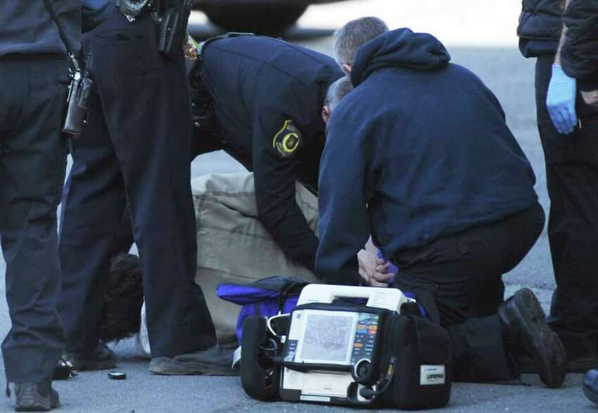 The victim of a gunshot wound is attended to by Albany Fire Department Paramedics behind the an apartment complex at 6 Brevator Street in Albany, N.Y. Feb. 10, 2012. (Skip Dickstein / Times Union)