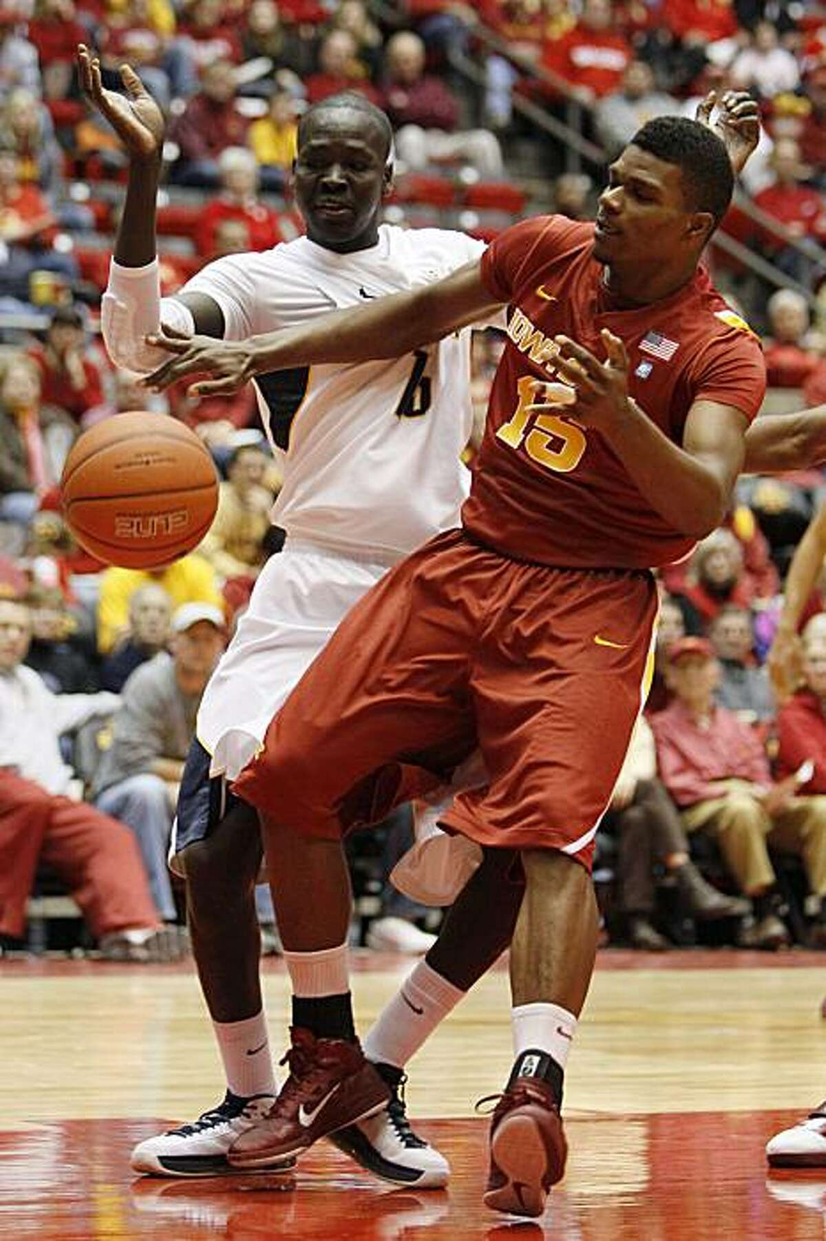Iowa State forward Calvin Godfrey, right, fights for a rebound with California forward Bak Bak, left, during the first half of an NCAA college basketball game, Saturday, Dec. 4, 2010, in Ames, Iowa. (AP Photo/Charlie Neibergall)