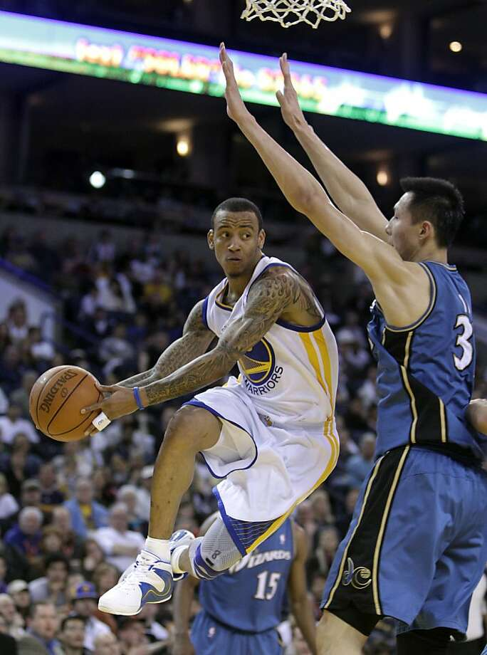 Golden State Warriors' Monta Ellis, left, looks to pass away from Washington Wizards' Yi Jianlian, of China, during the first half of an NBA basketball game, Sunday, March 27, 2011, in Oakland, Calif. Photo: Ben Margot, AP