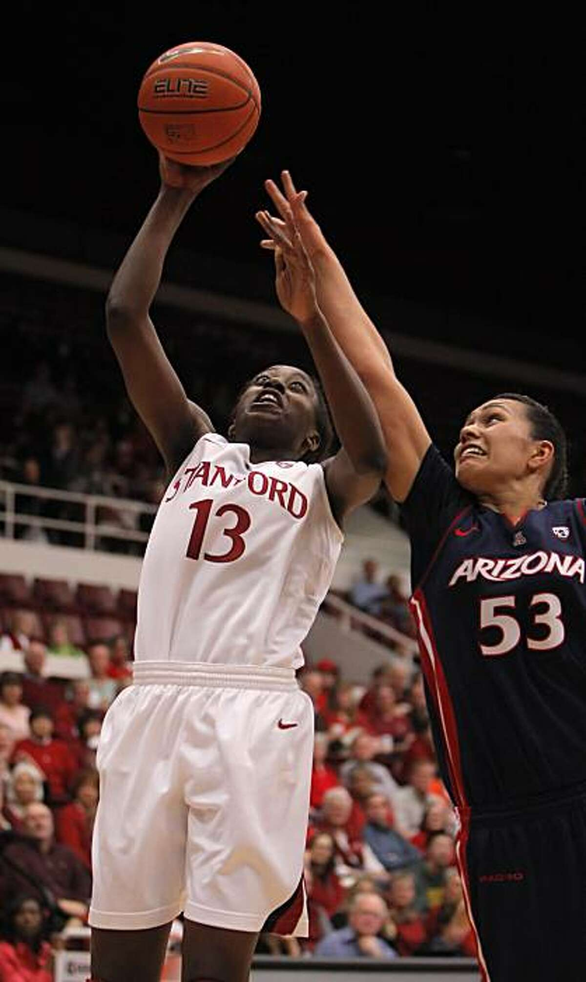Chiney Ogwumike puts up a shot in the second period as Arizona's Soana Lucet tries to defent. The Stanford women's basketball team played the Arizona Wildcats at Maples Pavilion at Stanford, Calif., on Thursday, January 6, 2011. The Cardinal defeated the Wildcats, 87-54.