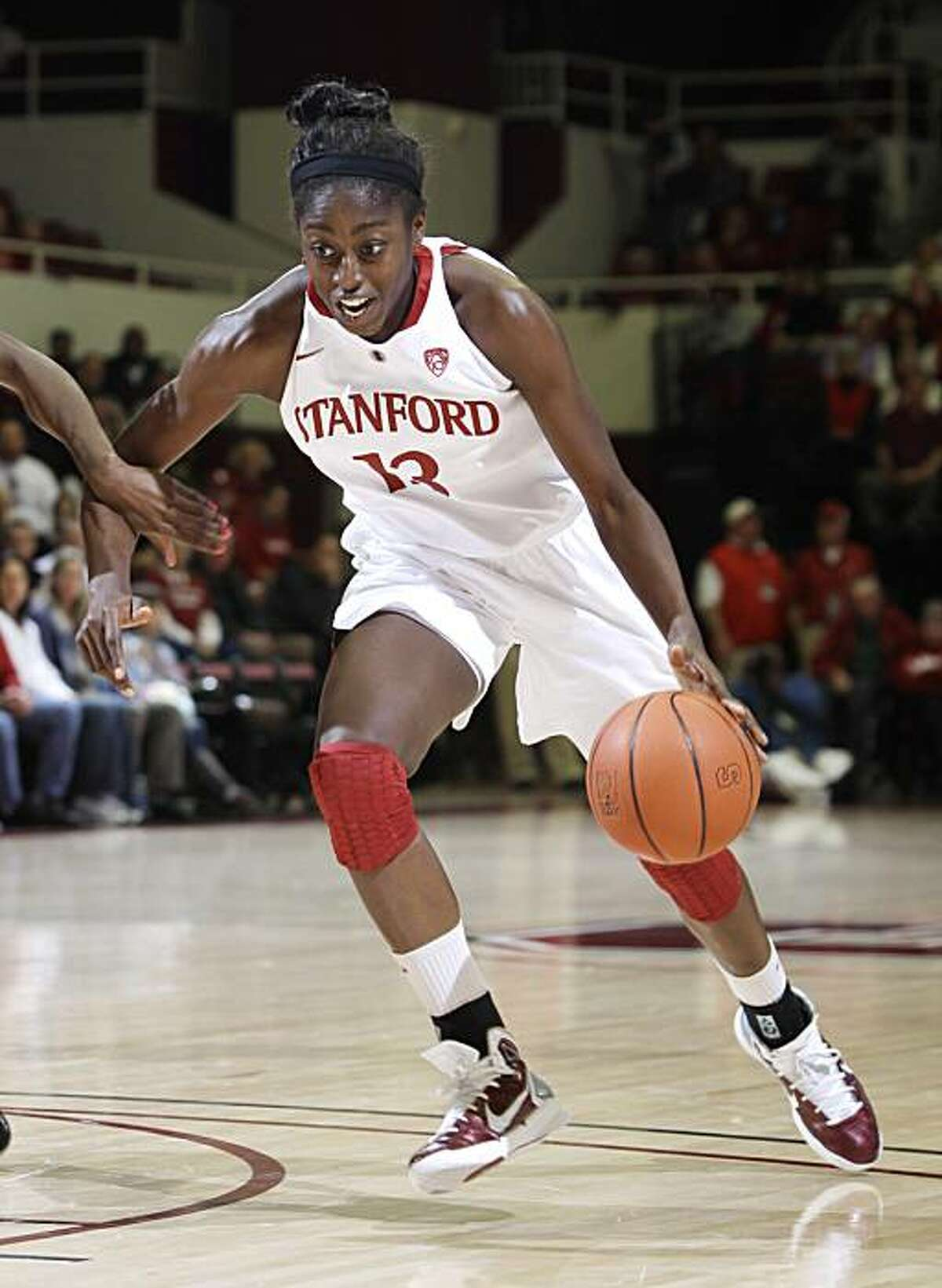 Stanford forward Chiney Ogwumike (13) drives to the basket against Arizona in the first half of an NCAA college basketball game in Stanford, Calif., Thursday, Jan. 6, 2011.